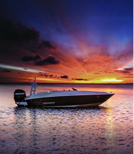 bayliner boat on the sea with a sunset background
