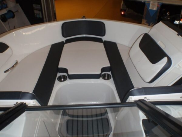 two boat seat with table in the middle