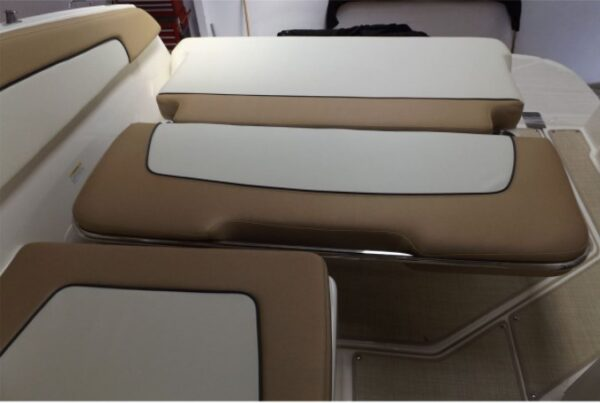 brown and white small cushion boat interior