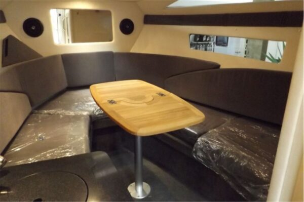 small dining area with brown long table and couch