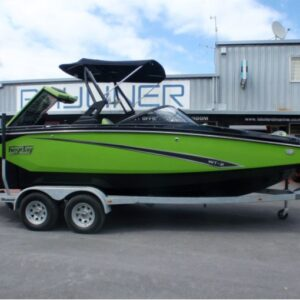 green boat on a boat trailer