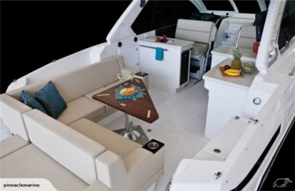 one long seat cushion and cockpit table