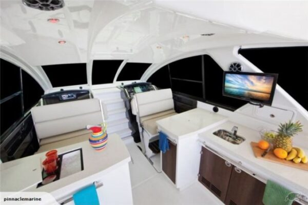 cabin with small kitchen and two seats