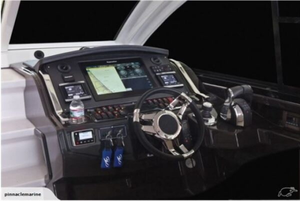 motor boat control panel and steering wheel