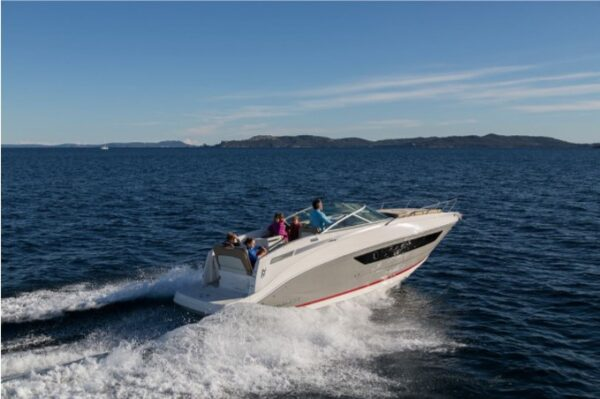people on a small speed boat