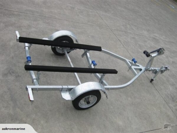 small boat trailer with three blue roller