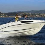 two women riding an outboard boat on a day time