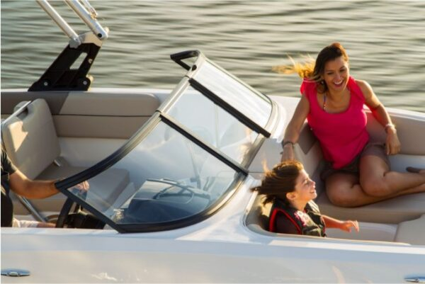 two people enjoying riding on a boat