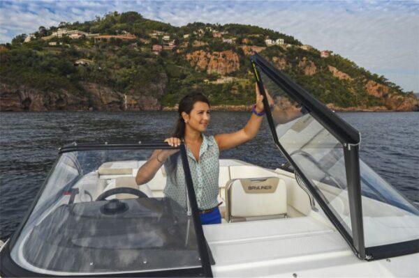 woman touching the boat windshield