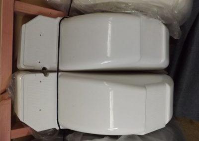 two white plastic trailer fenders