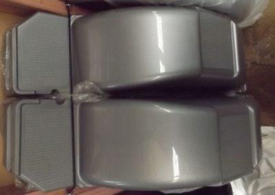two grey plastic trailer fenders